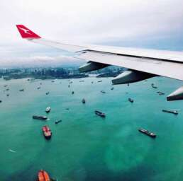 Qantas airplane approaching Changi international airport in Singapore
